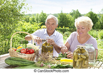Pickling - Mature couple making home made pickles