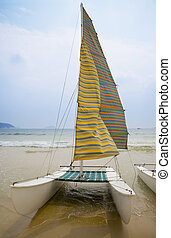 Catamaran standing on the seashore