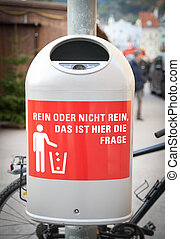 Dustbin in the City with German Phrase
