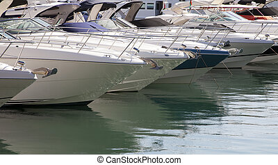 Moored motorboats - A lot of expensive motorboats moored in...