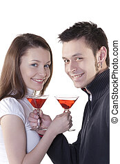 Young couple - Young happy couple with cocktails in their...