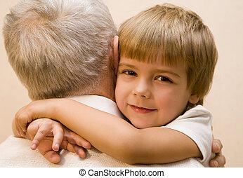grandchild - Little boy embrace his grandpa