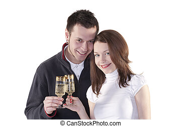Young couple - Young happy couple with champagne glasses in...