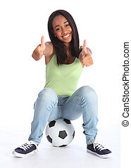 Teenage sports girl two thumbs up happy success - Football...