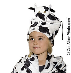 Little girl dressed in cow costume