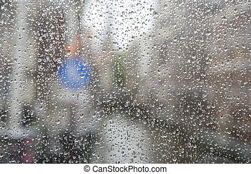Rain drops on a glass window. Abstract texture.