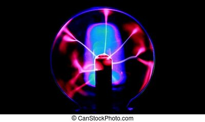 Tongues of plasma moving in glass sphere, shown on dark...