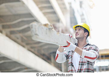 hard worker on construction site - handsome hard worker...