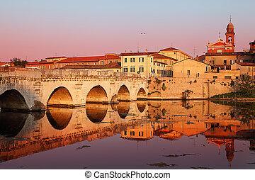 Tiberius' Bridge at sunset. Rimini, Italy