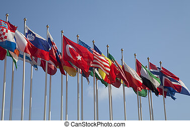United Flags - Rows of flags blowing in the wind against...
