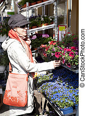 woman buying flowers - Caucasian young woman shopping in...