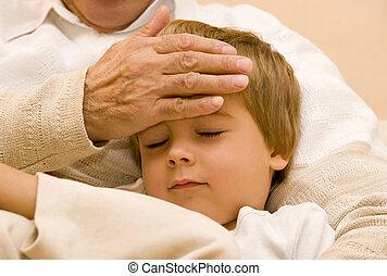 senior with his grandchild - Grandpa touch the head of his...