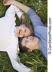sweethearts - Young pair of sweethearts in the grass