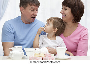 Mature couple with grandchild have a breakfast