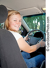 Pretty Blond Teen Driving - Pretty blond teenager sitting in...