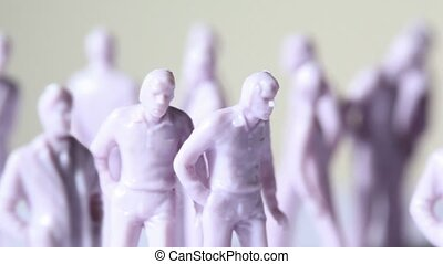 Group of little unpainted toy human stand, composition...