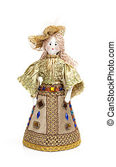 Homemade rag doll in traditional clothes over white