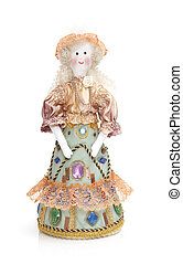 Hand made rag doll in traditional clothes over white