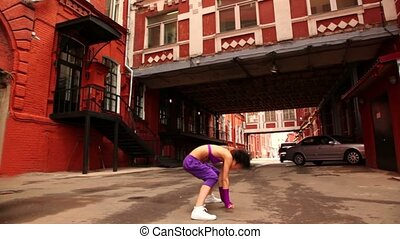 woman dance active at city lane between houses