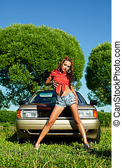 Attractive woman ready for washing a car - Attractive young...