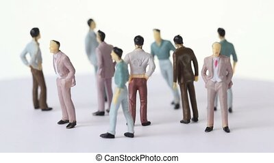 Several painted toy men stand and drop shadows, all...