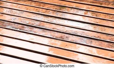 Rain falling on Planks.