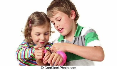 Two children plays with furry handcuffs - Two children boy...