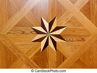 Wood star - Wood marquetry star shape at floor parquet