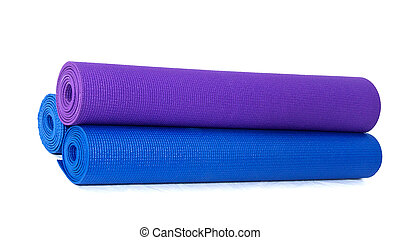 three rolled exercise yoga mats stacked on white - three...