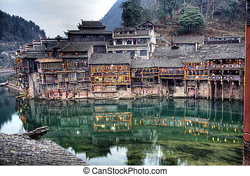 Ancient Chinese Houses over water in the town of Fenghuang...