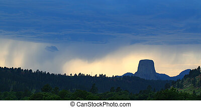 Devils Tower National Monument - Evening rainstorm against...