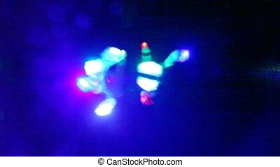 Hands moves with illuminated LED lamps for rave party on...