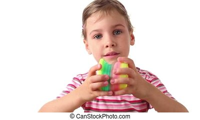 Girl holds interesting toy in both hands, then rises hands...