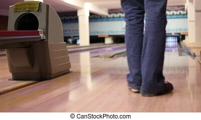 Man throw ball and hit all pins - strike - Man in jeans...