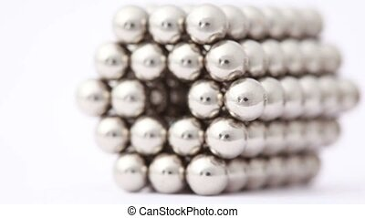 Hand take magnet balls in hexagonal tunnel structure,...