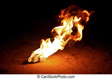Fire Pois Flaming On Sandy Floor