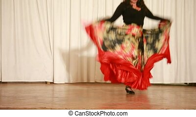 Gypsy female on high heels perform traditional dance