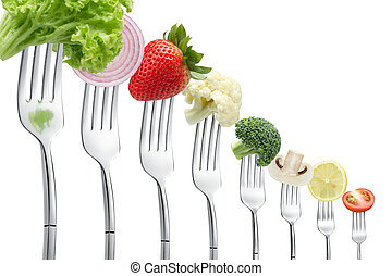 forks with vegetables in a row isolated on white