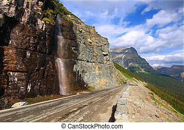 Going To The Sun Road - Montana - Waterfall flows down from...