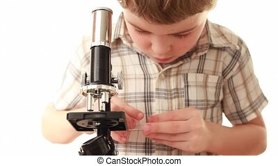 Little boy prepare specimen pouring it on glass slide