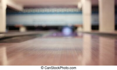 Foot of man, which throw ball and hit all pins - strike in...