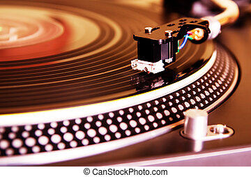 Turntable playing vinyl record - Record player spinning the...