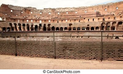Woman walk along border of one of Colosseum levels - Woman...