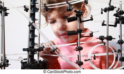 Little girl have fun with space marble run, closeup view