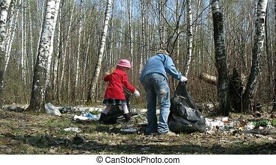 Two children collect trash to garbage bags in forest, time...
