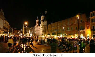 Tourists walk on Piazza Navona