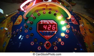 colorful slot machine with rotating white bulbs, child...