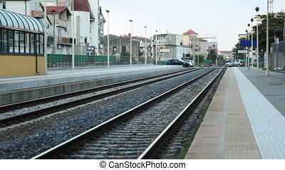 Platform and railway lines near train station - platform and...