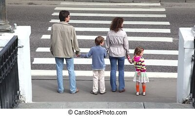 Family goes by pedestrian crossing road, parents keep...