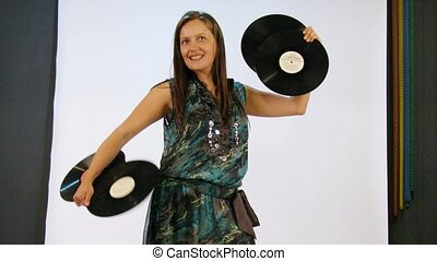 Young woman have photo session with vinyls in studio, time...
